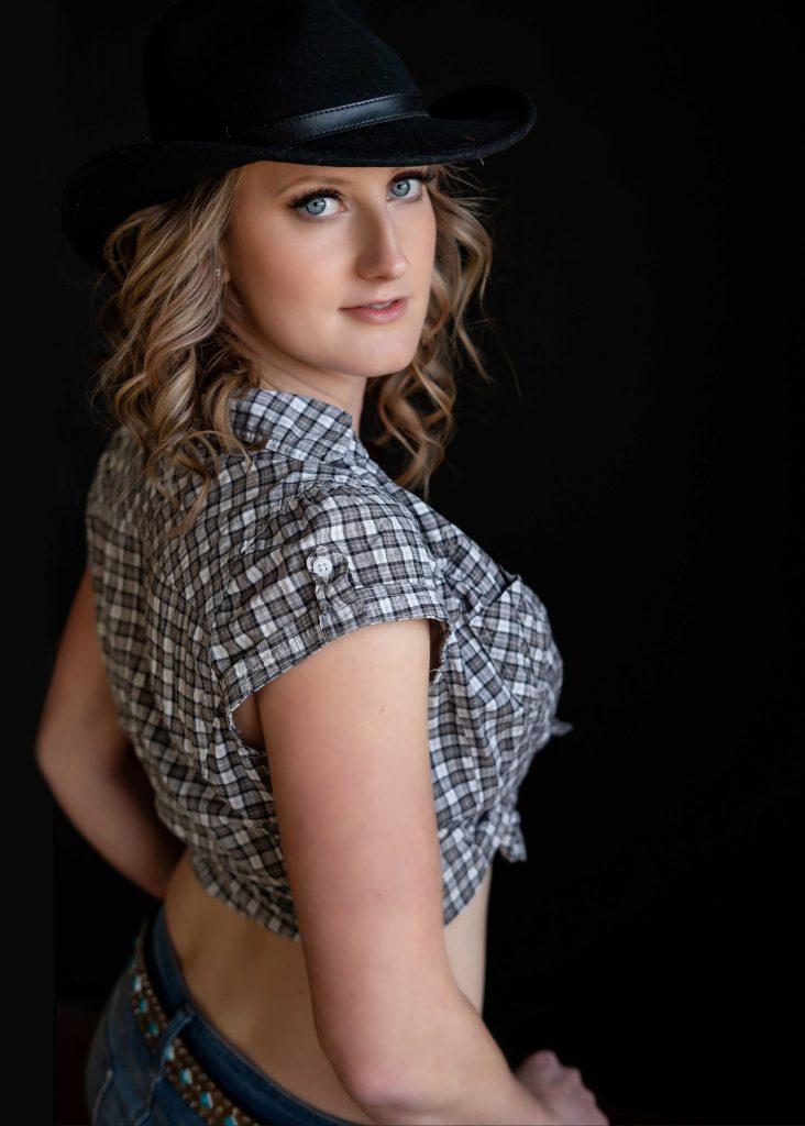 Women posing in cowboy hat for boudoir shoot in Victoria BC photography studio.