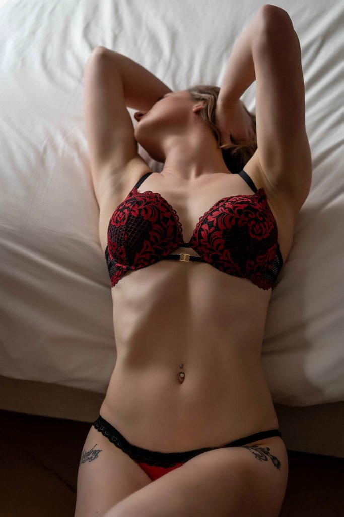 Boudoir fashion detail of red and black lingerie.