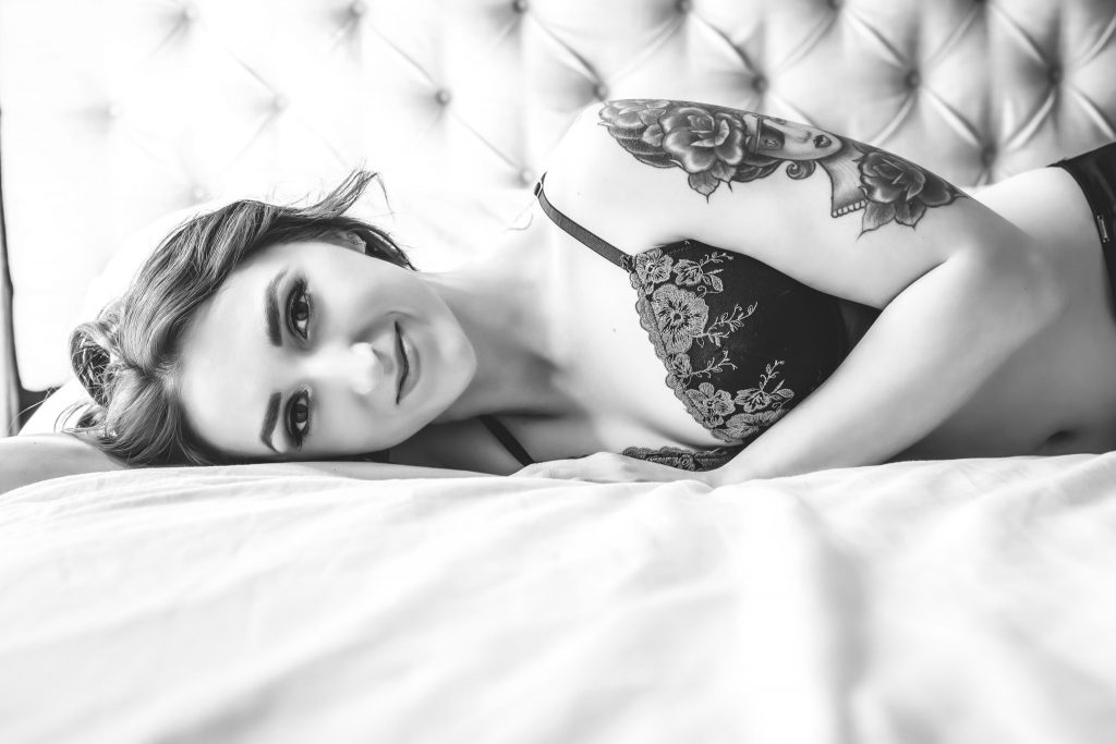 Smiling black and white boudoir image from photography session.
