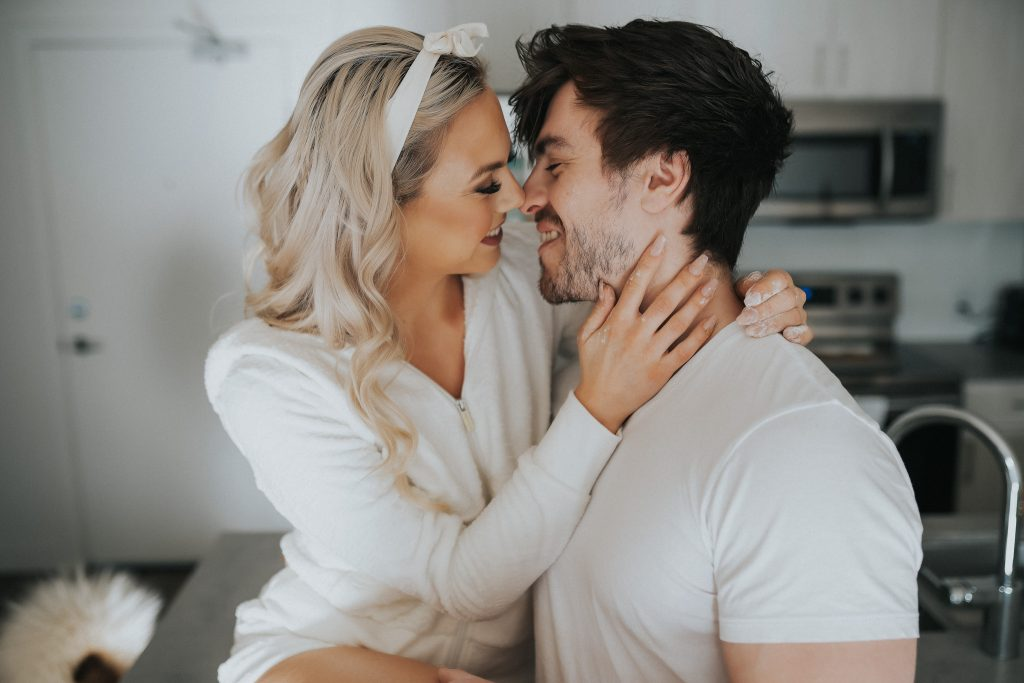 Couple wearing white kissing