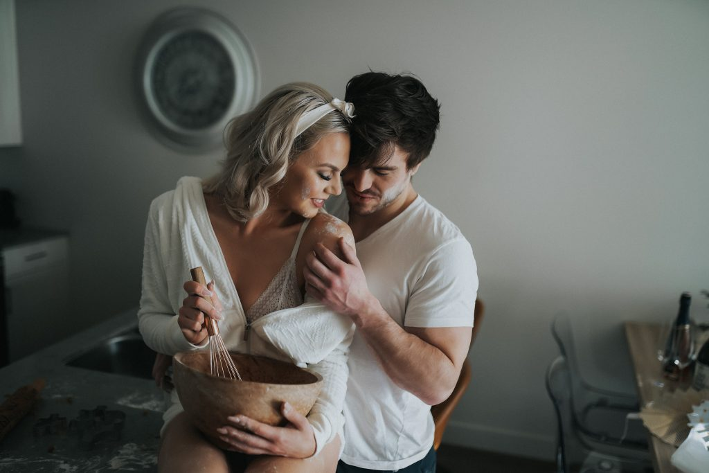 Blond model and her boyfriend baking