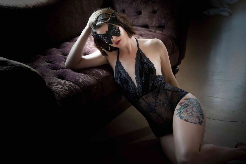 Boudoir model with black body suite and mask