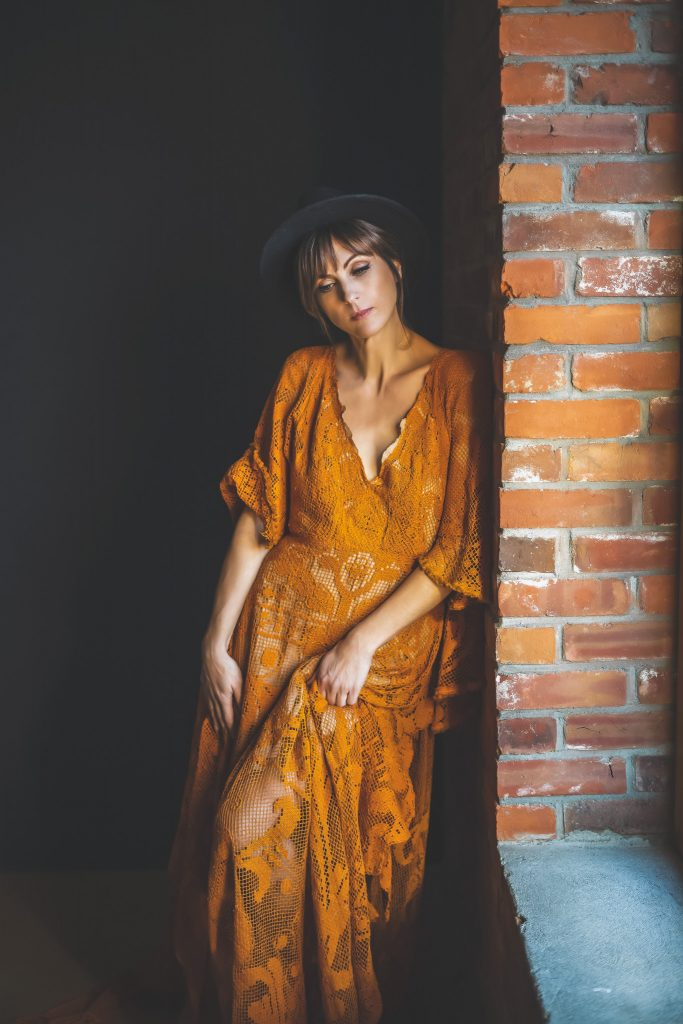 Woman posing in bohemian dress by Reclamation Design
