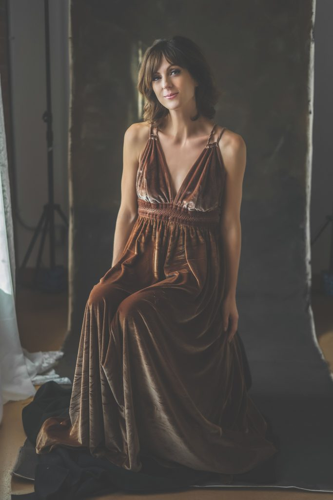 Woman in brown velvet dress.