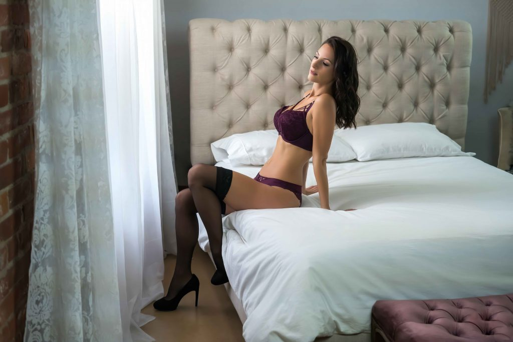 woman modelling on bed