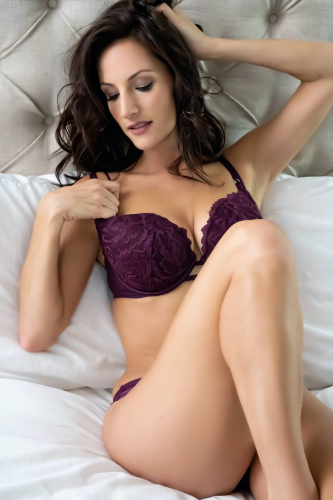woman modelling in purple lingerie for boudoir session