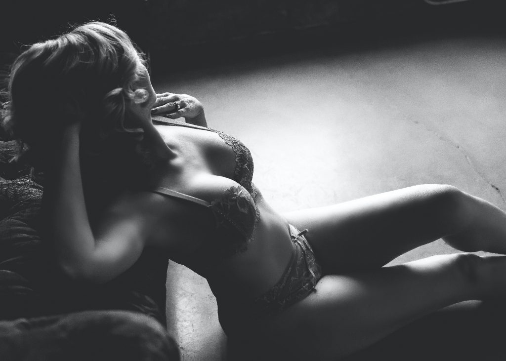 black and white image of woman posing in lingerie