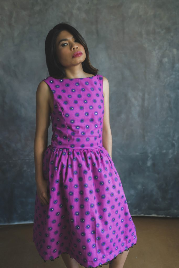 woman modelling pink patterned dress