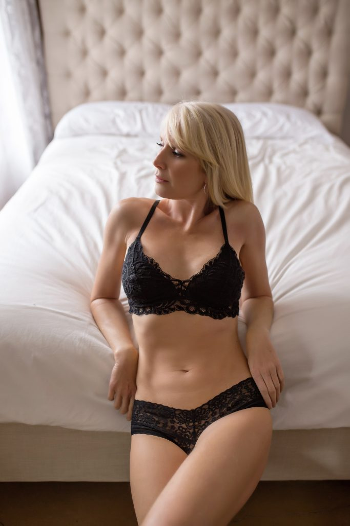 Blond model posing for over 40 boudoir session