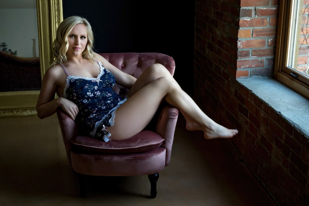 woman posing in boudoir studio on chair