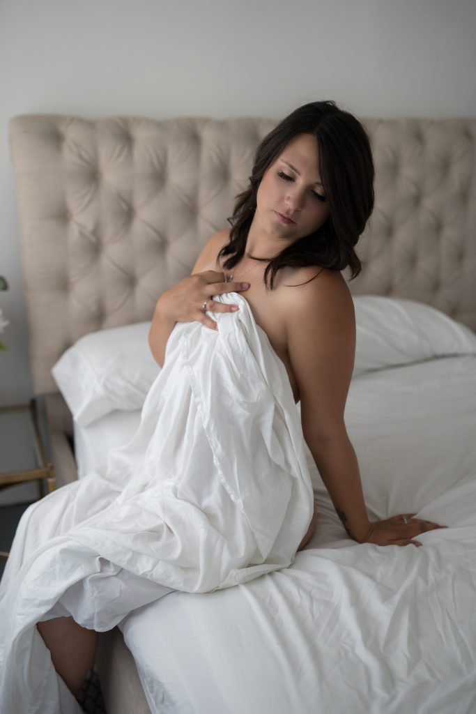 white sheet boudoir portrait